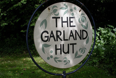 The Garland Hut sign